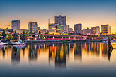 Tacoma, Washington, USA downtown skyline at dusk on Commencement Bay.