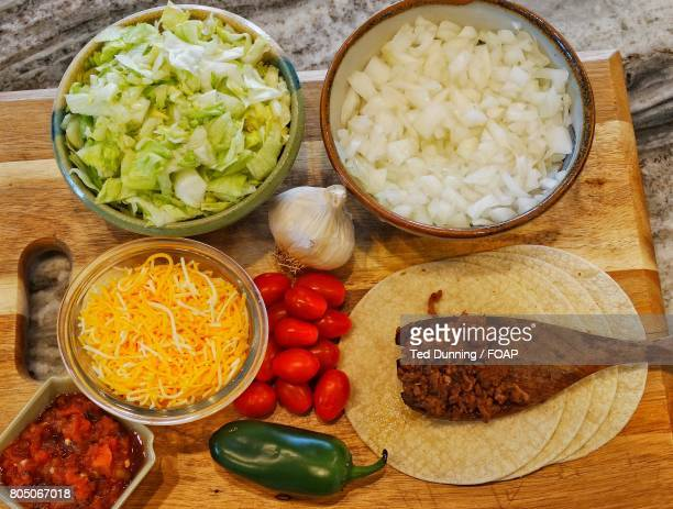 Tacos with chopped vegetables in bowl