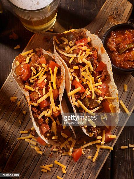 Tacos With Salsa, Cheese and a Beer