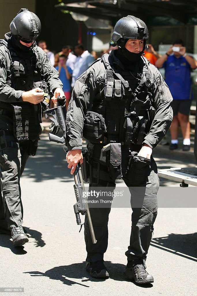 Tactical police assemble outside NSW Parliament House on Macquarie Street on December 20, 2013 in Sydney, Australia. The NSW Parliament House was locked down due to a security threat outside the building. A man has been apprehended after a stand off with riot police.