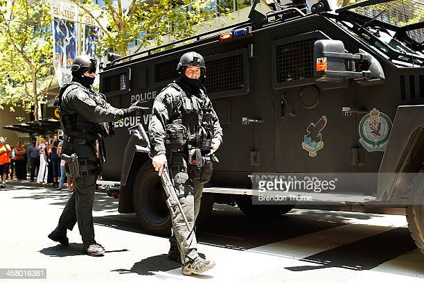 Tactical police assemble outside NSW Parliament House on Macquarie Street on December 20 2013 in Sydney Australia The NSW Parliament House was locked...