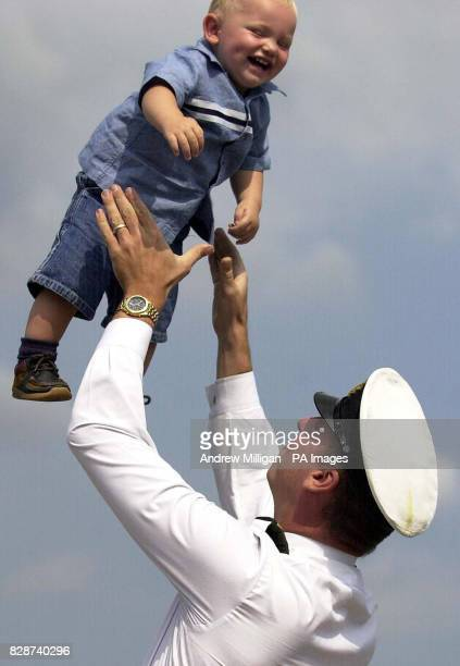Tactical Systems officer John Livesey greets his 16monthold son Harry as HMS Splendid returns from the Gulf to HM Naval base Clyde Faslane * The 107...
