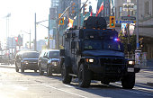 A tactical vehicle leaves the security perimeter on Wellington Street just a couple blocks away from Parliament Hill on October 22 2014 in Ottawa...