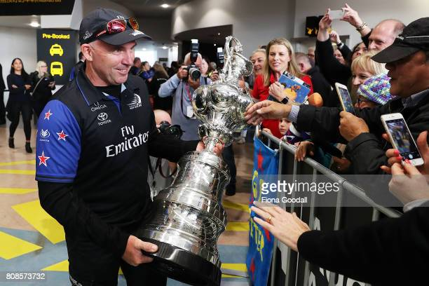 Tactician Ray Davies lets the crowd enjoy the America's Cup as Team New Zealand arrive at Auckland International Airport with the Americas Cup Trophy...