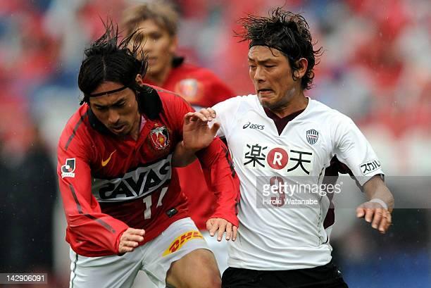 Tadaaki Hirakawa of Urawa Red Diamonds and Takahito Soma of Vissel Kobe compete for the ball during the JLeague match between Urawa Red Diamonds and...