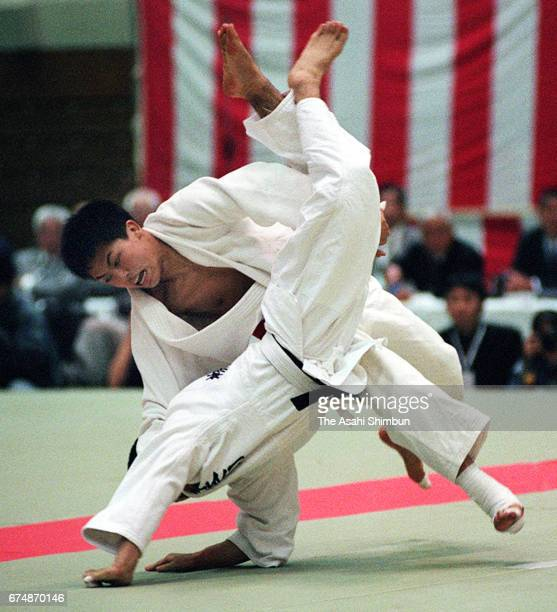 Tadahiro Nomura and Kazuhiko Tokuno compete in the Men's 60kg final during the All Japan Judo Invitational Championships by Weight Category at...