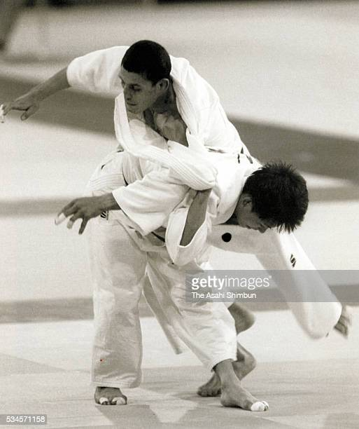 Tadahiro Nomura of Japan and Leonardo Carcamo Gutierrez of Honduras compete compete in the Judo Men's 60kg first round during the Atlanta Summer...