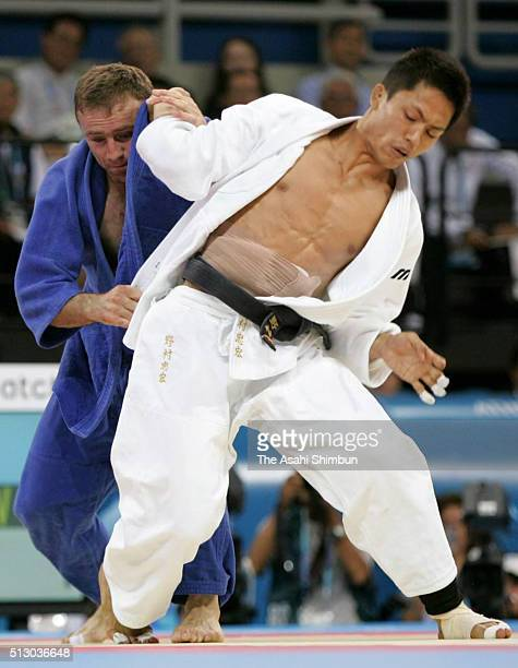 Tadahiro Nomura of Japan and Nestor Khergiani of Georgia compete in the Judo Men's 60kg final at the Ano Liossia Olympic Hall during day one of the...