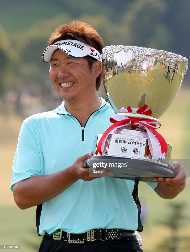 Tadahiro Takayama poses for photographs after winning the Token Homemate Cup 2011 at Token Tado Country Club Nagoya on April 17, 2011 in Kuwana, Mie, Japan.