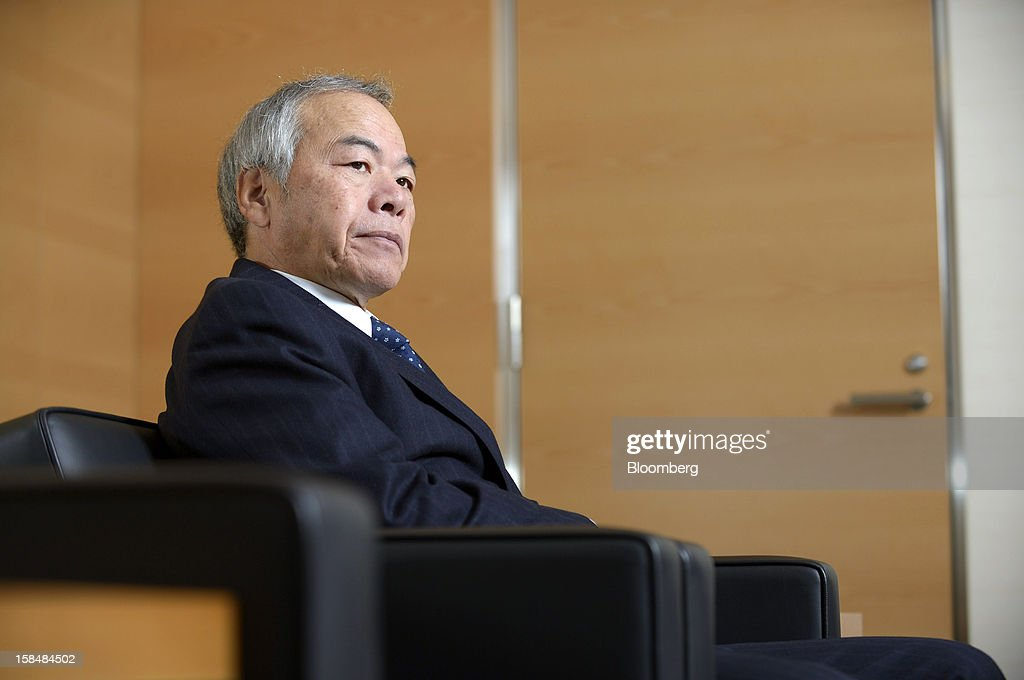 Tadahito Yamamoto, president of Fuji Xerox Co., listens during an interview in Tokyo, Japan, on Monday, Dec. 17, 2012. Fuji Xerox, Japan's biggest maker of color printers, may miss its sales target for the next fiscal year because of slowing demand. Photographer: Akio Kon/Bloomberg via Getty Images