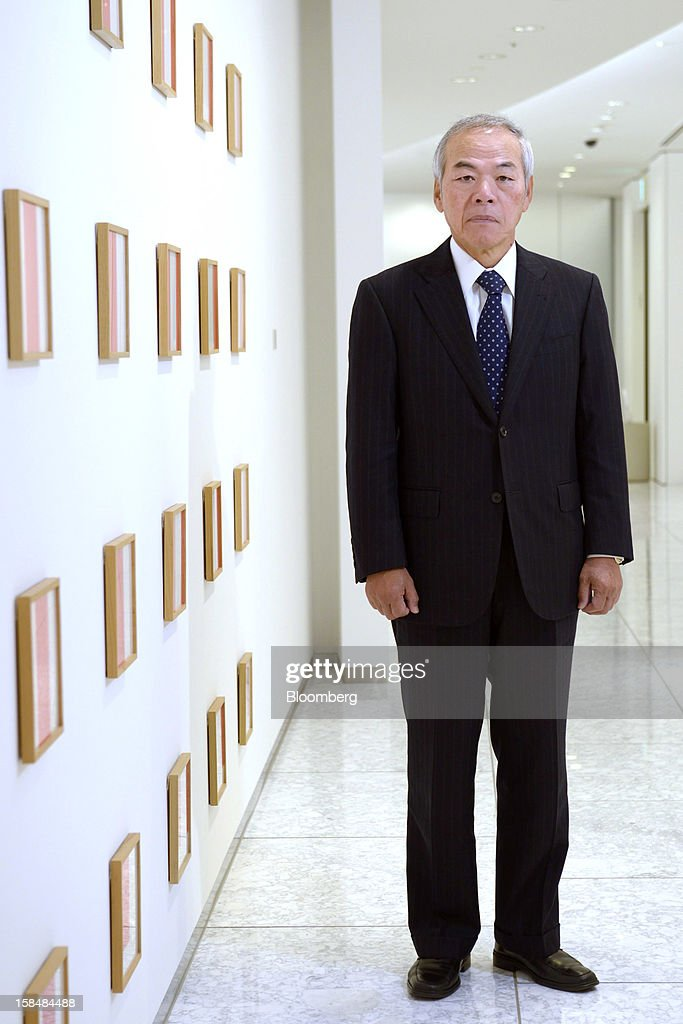 Tadahito Yamamoto, president of Fuji Xerox Co., poses for a photograph in Tokyo, Japan, on Monday, Dec. 17, 2012. Fuji Xerox, Japan's biggest maker of color printers, may miss its sales target for the next fiscal year because of slowing demand. Photographer: Akio Kon/Bloomberg via Getty Images