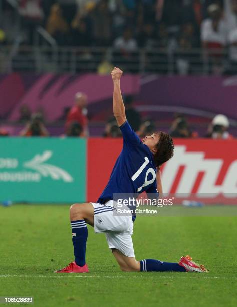 Tadanari Lee of Japan celebrates his goal in extra time during the AFC Asian Cup Final match between the Australian Socceroos and Japan at Khalifa...