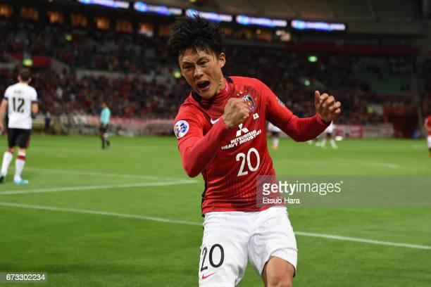 Tadanari Lee of Urawa Red Diamonds celebrates scoring his team's third goal during the AFC Champions League Group F match between Urawa Red Diamonds...