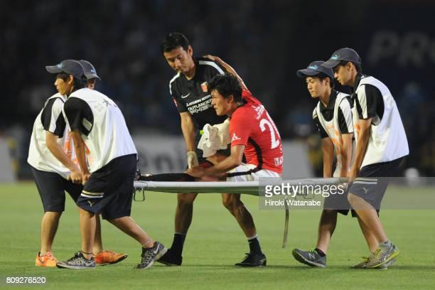 Tadanari Lee of Urawa Red Diamonds is taken off by a stretcher during the JLeague J1 match between Kawasaki Frontale and Urawa Red Diamonds at...