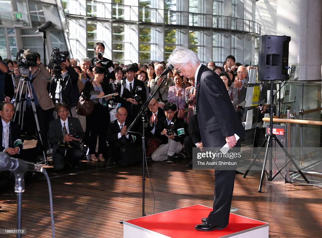 Tadao Terasaka, chief director of Nitten, bows at the start of the annual Japan Fine Arts Exhibition at the National Art Center on November 1, 2013 in Tokyo, Japan. The Asahi Shimbun reported that an influential adviser to Nitten instructed the chief judge to unfairly award winning slots in the 'Tenkoku' (seal engraving) section of the 'Calligraphy' category to eight major schools in fiscal 2009. Nitten, for the first time in its history, canceled the prime minister's award and the education minister's award for all five categories of the exhibition.