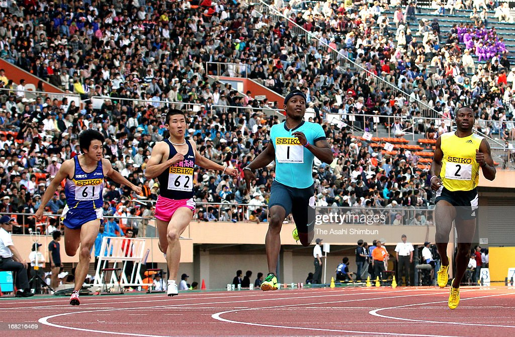 Tadashi Eriguchi, Yoshihide Kiryu, Mike Rodgers and Derrick Atkins of Bahama compete in the Men's 100m during the Seiko Golden Grand Prix Track & Field at the National Stadium on May 5, 2013 in Tokyo, Japan.