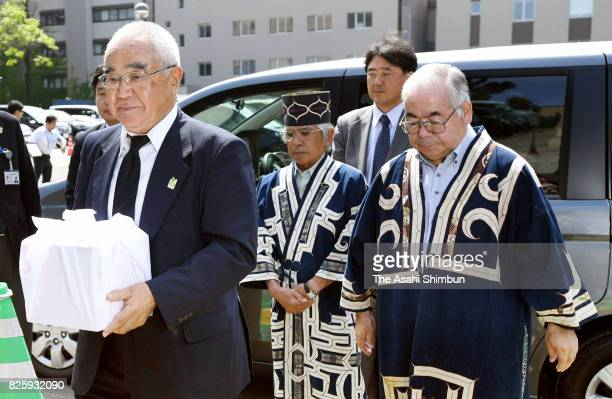 Tadashi Kato executive director of the Ainu Association Hokkaido holds the boxed skull of an Ainu individual that was repatriated from Germany at...