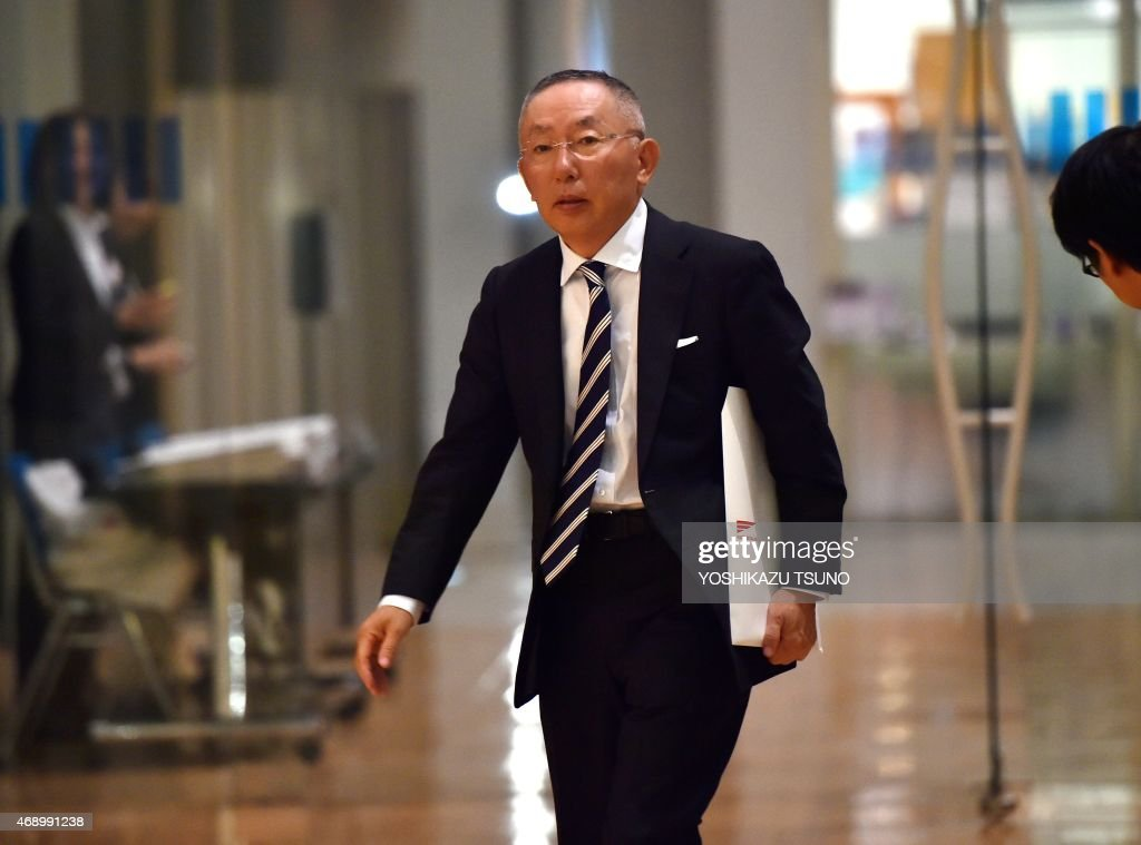 <a gi-track='captionPersonalityLinkClicked' href=/galleries/search?phrase=Tadashi+Yanai&family=editorial&specificpeople=558842 ng-click='$event.stopPropagation()'>Tadashi Yanai</a>, CEO of Fast Retailing, operator of Japan's fast fashion giant Uniqlo arrives at the Tokyo Stock Exchange to announce the company's first half financial result ended February in Tokyo on April 9, 2015. Fast Retailing said robust foreign sales and a weaker yen had given a more than 50-percent boost to its half-year net profit. Fast Retailing said net profit reached 104.7 billion yen (871 million USD), a 56.2 percent rise from the 67.1 billion yen logged a year ago. AFP PHOTO / Yoshikazu TSUNO