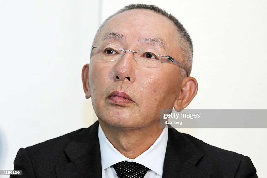 <a gi-track='captionPersonalityLinkClicked' href=/galleries/search?phrase=Tadashi+Yanai&family=editorial&specificpeople=558842 ng-click='$event.stopPropagation()'>Tadashi Yanai</a>, chairman, president and chief executive officer of Fast Retailing Co., pauses during a news conference in Tokyo, Japan, on Thursday, Oct. 10, 2013. Fast Retailing, Asias largest clothing retailer, forecast profit that missed analyst estimates after saying earnings for its Uniqlo business in Japan fell as it expanded discounts and disposed inventory. Photographer: Junko Kimura/Bloomberg via Getty Images