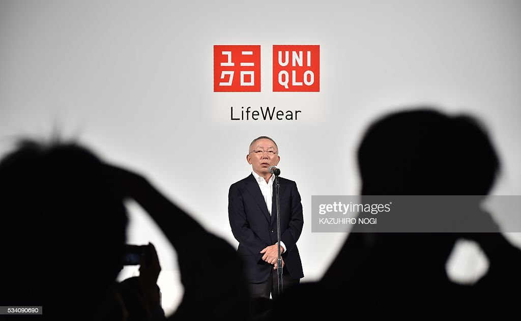 Tadashi Yanai, the president and CEO of Fast Retailing, the parent company of Japanese casual clothing chain Uniqlo, delivers a speech during the UNIQLO 2016 fall-winter press preview in Tokyo on May 25, 2016. / AFP / KAZUHIRO