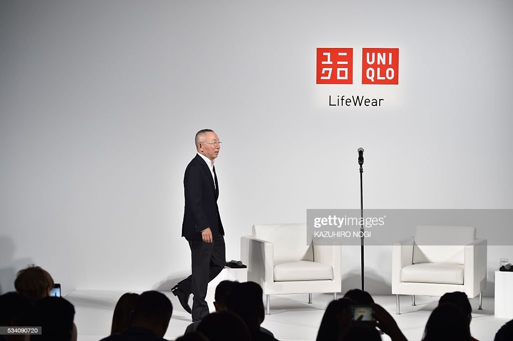 Tadashi Yanai, the president and CEO of Fast Retailing, the parent company of Japanese casual clothing chain Uniqlo, arrives to make a speech during the UNIQLO 2016 fall-winter press preview in Tokyo on May 25, 2016. / AFP / KAZUHIRO