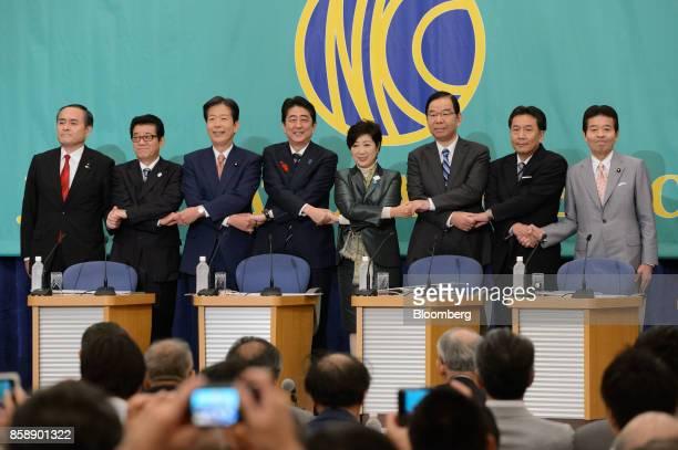 Tadatomo Yoshida president of the Social Democratic Party from left Ichiro Matsui governor of Osaka and secretarygeneral of Japan Restoration...