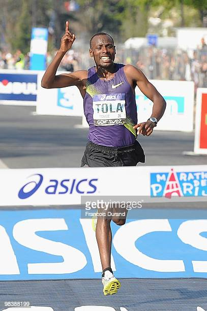 Tadesse Tola of Ethiopia crosses the finish line to win the 34th Paris Marathon on April 11 2010 in Paris France