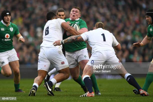 Tadhg Furlong of Ireland is tackled by Billy Vunipola and Joe Marler of England during the RBS Six Nations match between Ireland and England at the...