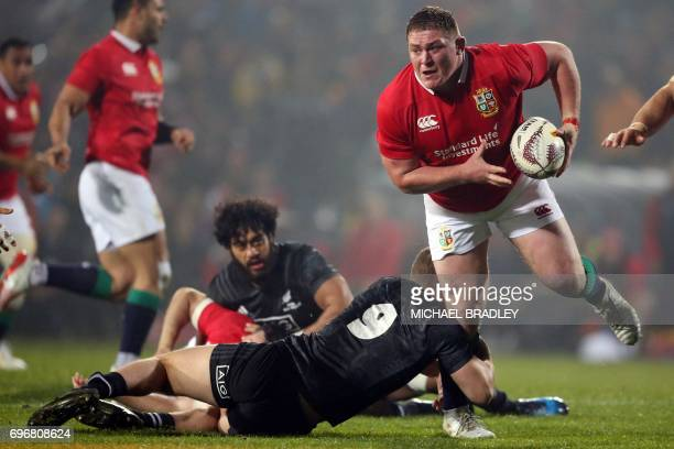 CORRECTION Tadhg Furlong of the British and Irish Lions is tackled by Maori All Blacks' Tawera KerrBarlow during the international rugby match...