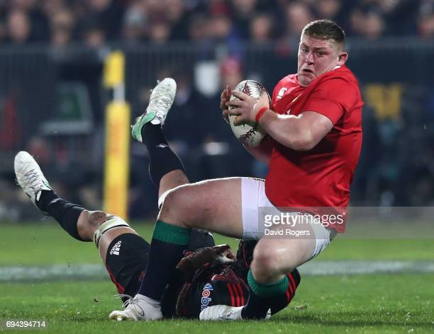 Tadhg Furlong of the Lions is tackled by Jordan Taufua of the Crusaders during the 2017 British Irish Lions tour match between the Crusaders and the...