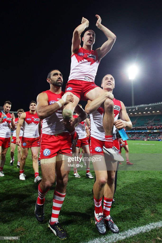 Tadhg Kennelly of the Swans is chaired off the field by Adam Goodes (L) and Ted Richards (R) after the round 24 AFL match between the Sydney Swans and the Brisbane Lions at the Sydney Cricket Ground on September 3, 2011 in Sydney, Australia.