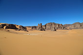 Tassili n'Ajjer is a heavily eroded sandstone rock formation in the Sahara desert, located on a vast plateau that encompasses southeastern Algeria, western Libya and northern Niger. It features over 3