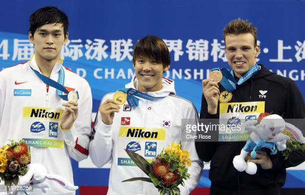 Tae Hwan Park of Korea poses with his gold medal and silver medalist Sun Yang of China and bronze medalist Paul Biedermann of Germany after the Men's...