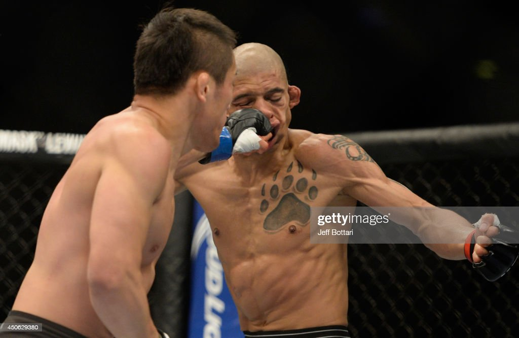 Tae Hyun Bang punches Kajan Johnson during the UFC 174 event at Rogers Arena on June 14, 2014 in Vancouver, British Columbia, Canada.