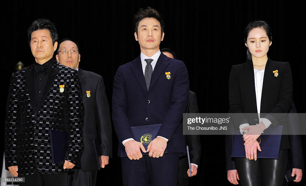 Tae Jin-A, <a gi-track='captionPersonalityLinkClicked' href=/galleries/search?phrase=Uhm+Tae-Woong&family=editorial&specificpeople=4438831 ng-click='$event.stopPropagation()'>Uhm Tae-Woong</a> and <a gi-track='captionPersonalityLinkClicked' href=/galleries/search?phrase=Han+Ga-In&family=editorial&specificpeople=7406282 ng-click='$event.stopPropagation()'>Han Ga-In</a> are awarded the Presidential Citation during the 27th Taxpayer Day at COEX Auditorium on March 4, 2013 in Seoul, South Korea.