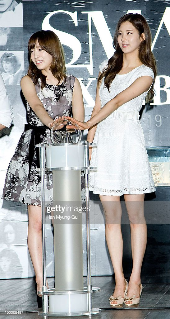Tae Yeon, Seo Hyun of South Korean girl group Girls' Generation attend during the 'S.M.ART Exhibition' opening ceremony held at Coex on August 09, 2012 in Seoul, South Korea.