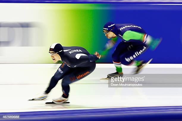 TaeBum Mo of South Korea and Jesper Hospes of the Netherlands compete in the 500m Mens race during day 2 of the ISU World Cup Speed Skating held at...