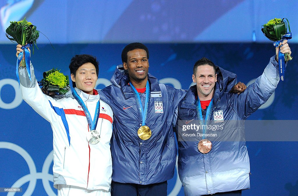 TaeBum Mo of South Korea celebrates winning Silver Shani Davis of United States Gold and Chad Hedrick of United States Bronze during the medal...