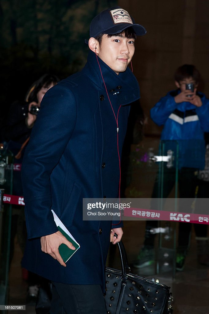 Taec-Yeon of <a gi-track='captionPersonalityLinkClicked' href=/galleries/search?phrase=2pm&family=editorial&specificpeople=6362819 ng-click='$event.stopPropagation()'>2pm</a> is seen at Gimpo International Airport on February 11, 2013 in Seoul, South Korea.