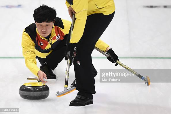 Taehwan Kim of Korea places a stone during the men's curling bronze medal game beween Chinese Taipei and Korea on day six of the 2017 Sapporo Asian...