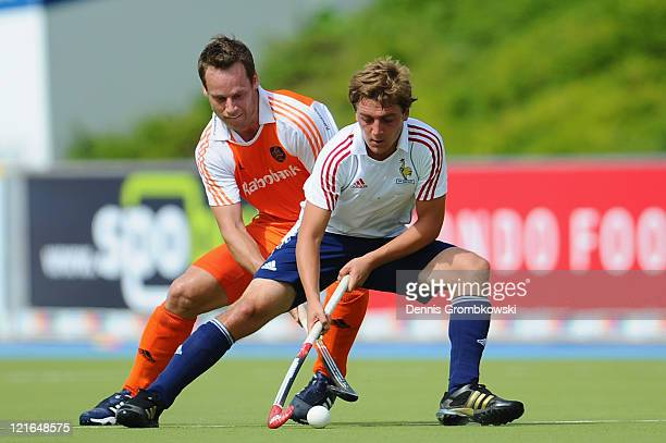 Taeke Taekema of Netherlands and Tom Genestet of France battle for the ball during the men´s EuroHockey Championships 2011 Pool B match between...