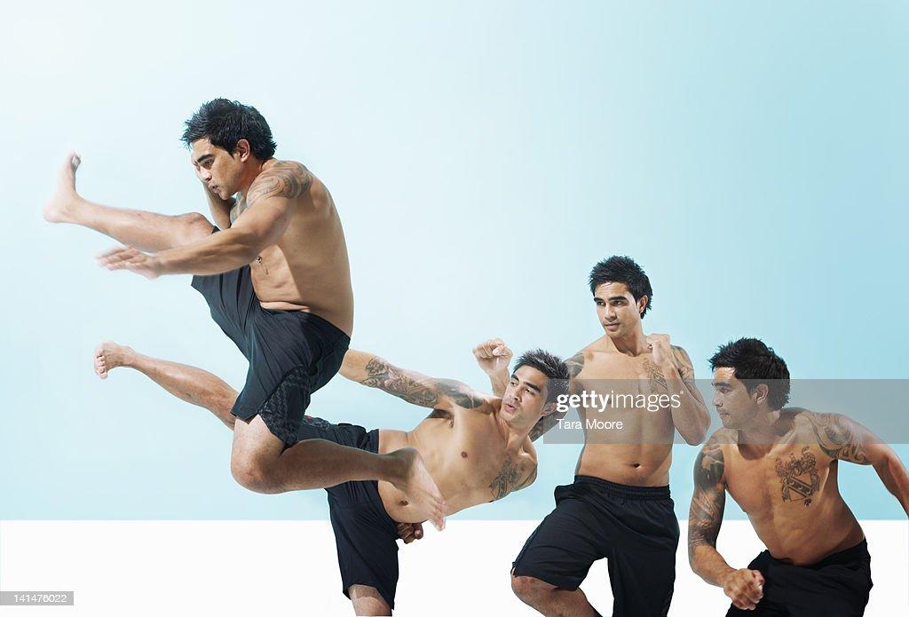 taekwondo man jumping up and kicking : Stock Photo