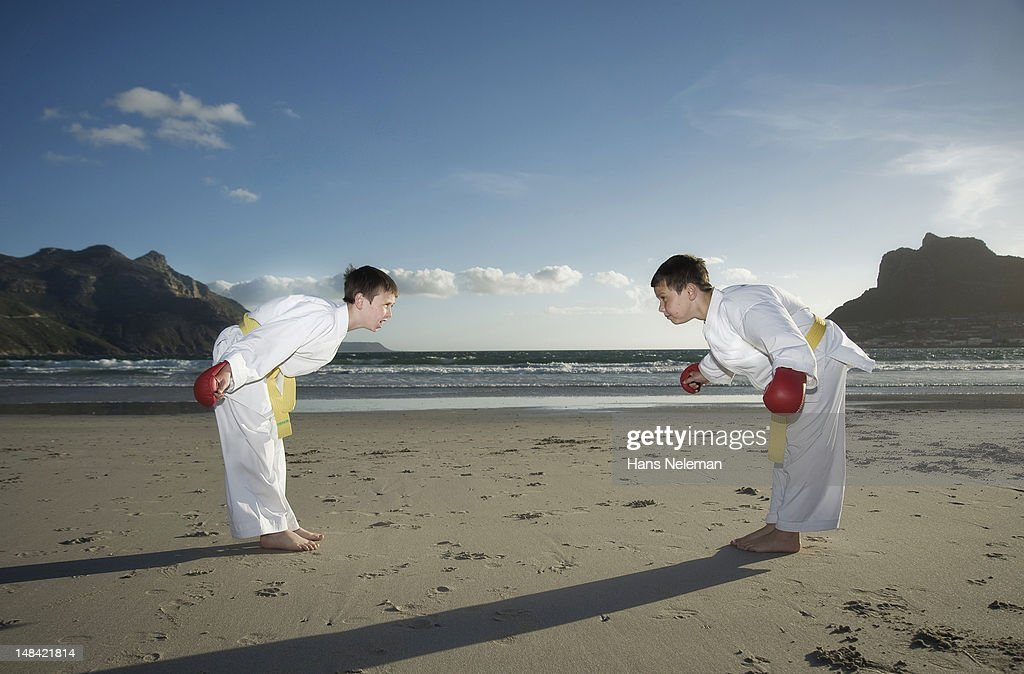 Taekwondo players bowing, side view : Stock Photo