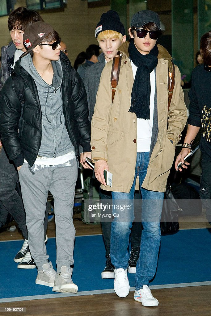 Taemin, Minho and <a gi-track='captionPersonalityLinkClicked' href=/galleries/search?phrase=Key+-+Korean+Singer&family=editorial&specificpeople=12538635 ng-click='$event.stopPropagation()'>Key</a> of South Korean boy band SHINee is seen at Incheon International Airport on January 13, 2013 in Incheon, South Korea.