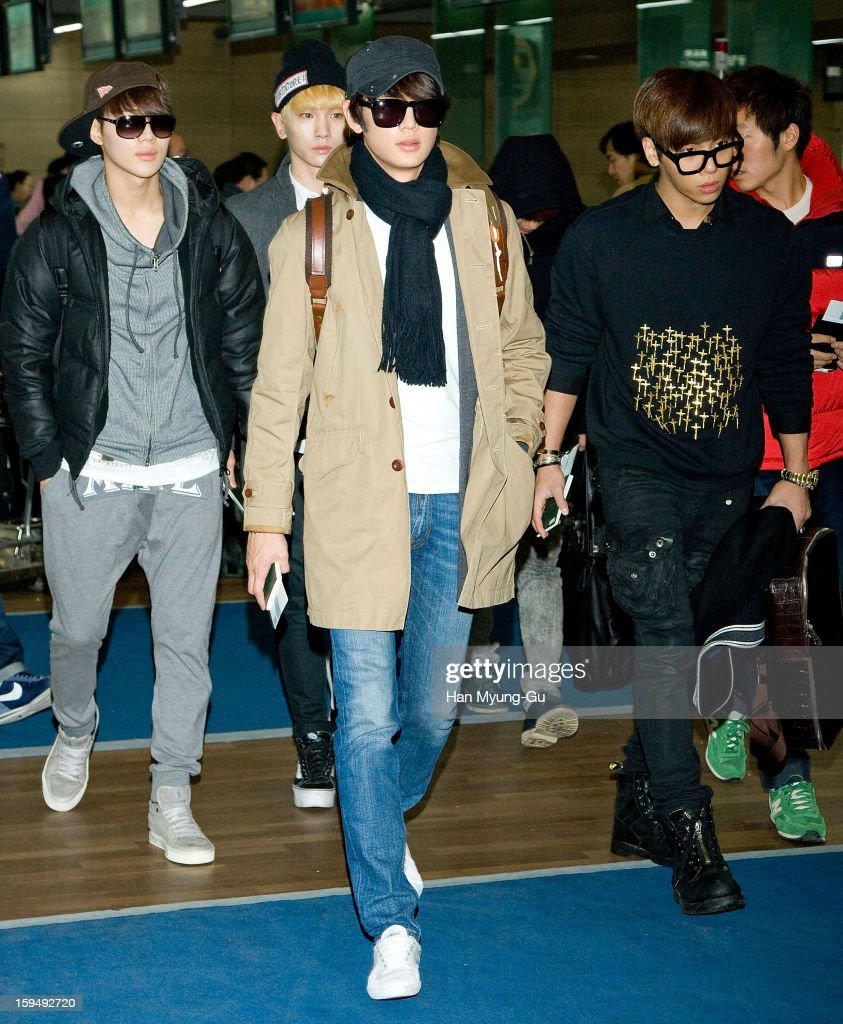 Taemin, Minho, Key and Jonghyun of South Korean boy band SHINee is seen at Incheon International Airport on January 13, 2013 in Incheon, South Korea.