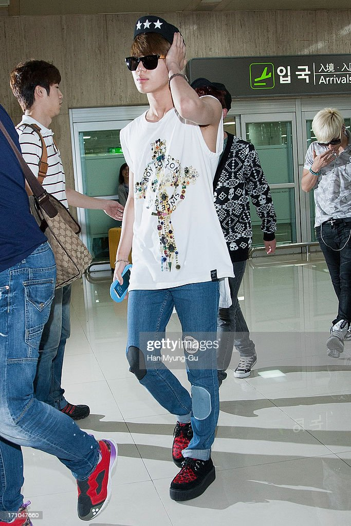 <a gi-track='captionPersonalityLinkClicked' href=/galleries/search?phrase=Taemin&family=editorial&specificpeople=5636164 ng-click='$event.stopPropagation()'>Taemin</a> of South Korean boy band SHINee is seen upon arrival at Gimpo International Airport on June 21, 2013 in Seoul, South Korea.