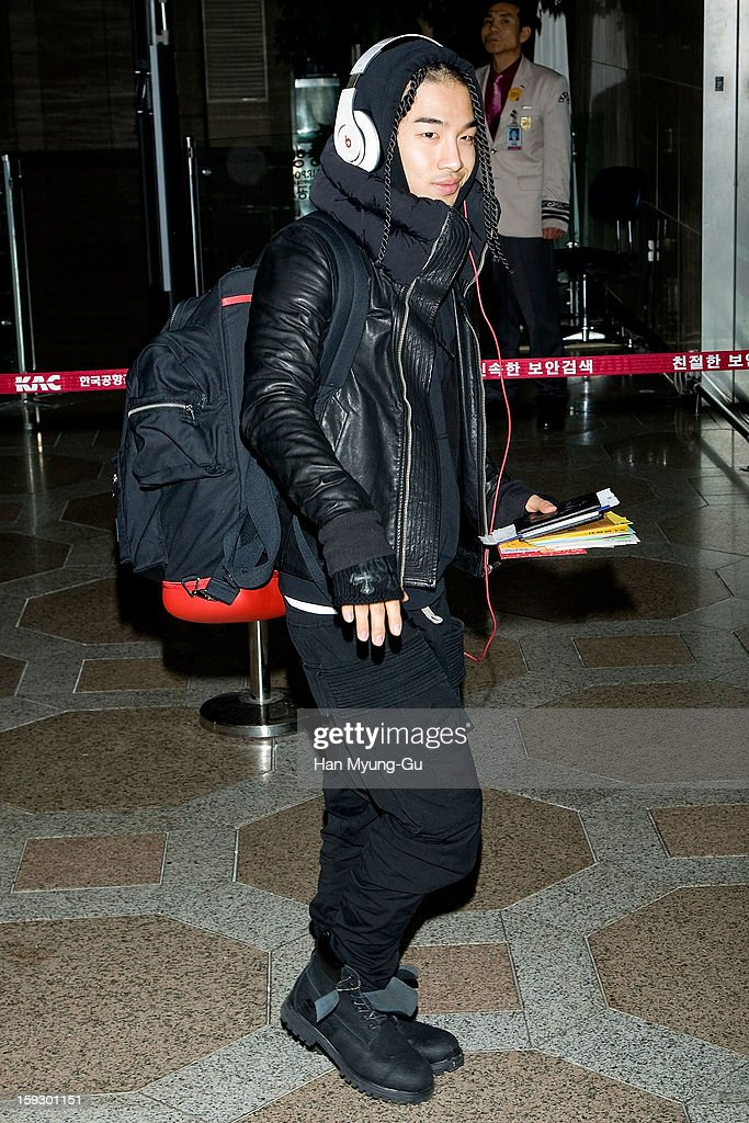 <a gi-track='captionPersonalityLinkClicked' href=/galleries/search?phrase=Taeyang&family=editorial&specificpeople=7420405 ng-click='$event.stopPropagation()'>Taeyang</a> of South Korean boy band Bigbang is seen at Gimpo International Airport on January 11, 2013 in Seoul, South Korea.