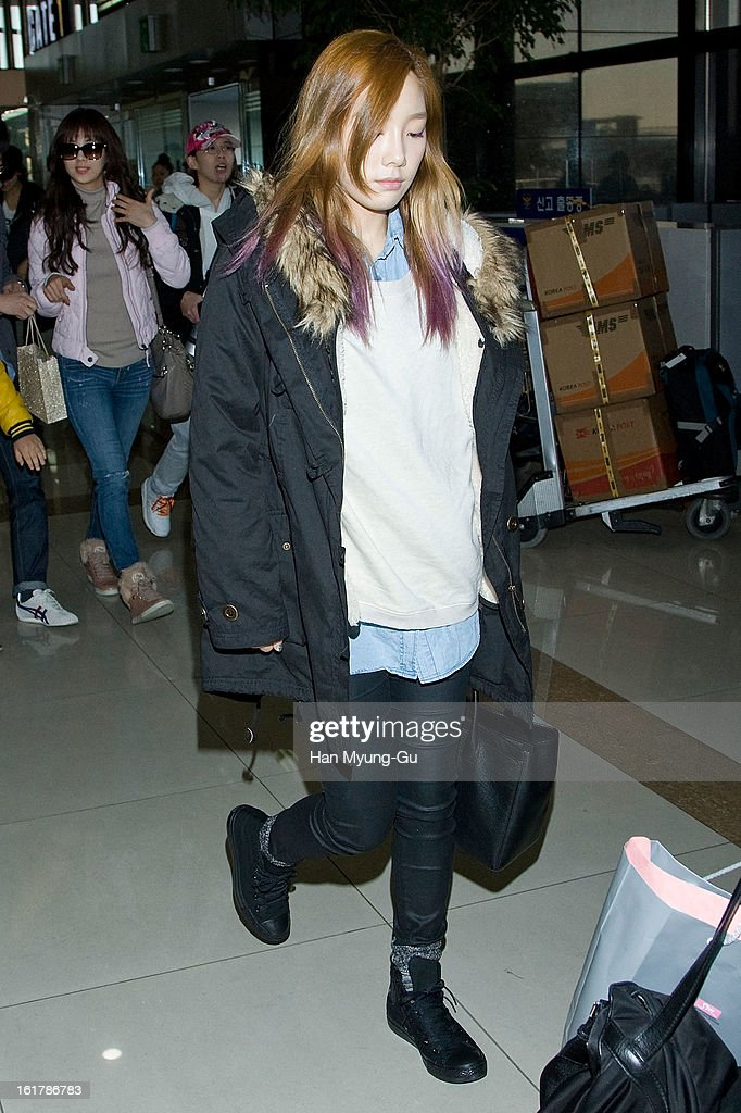Taeyeon of South Korean girl group Girls' Generation is seen at Gimpo International Airport on February 15, 2013 in Seoul, South Korea.