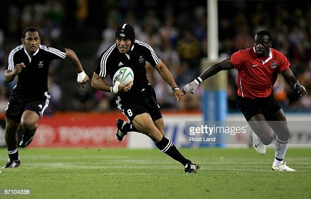 Tafai Ioasa of New Zealand breaks through the Kenya defence during the rugby sevens match between New Zealand and Kenya at the Telstra Dome on day...