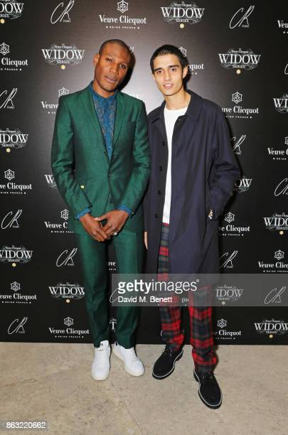 Tafari Hinds and Xavier Hickman attend The Veuve Clicquot Widow Series By Carine Roitfeld And CR Studio on October 19 2017 in London England